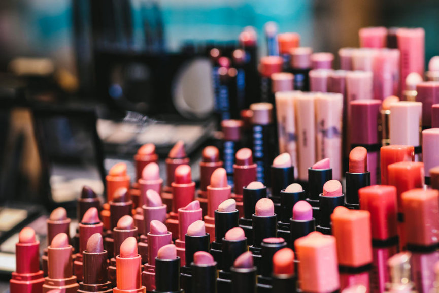 Cosmetic products neatly arranged on a counter top