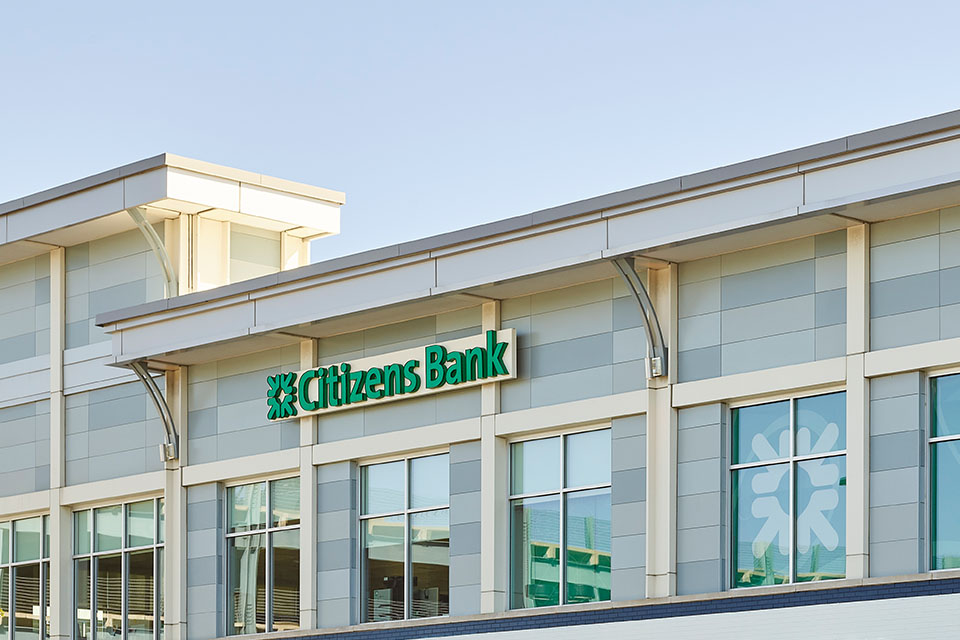 A glass building with the citizens bank logo displayed over the entrance