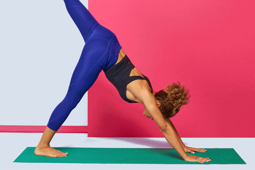 A woman in active wear doing yoga