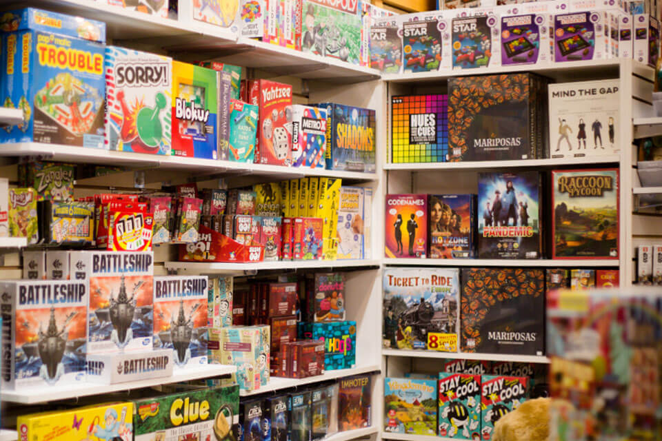 Shelves filled with various toys and games