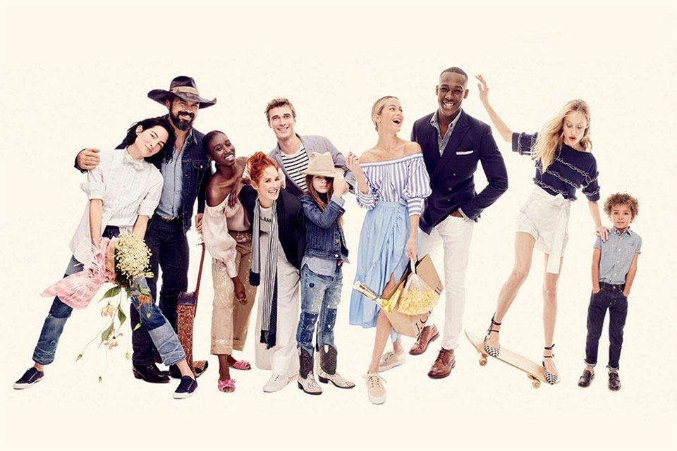 Several people posing for a group photo dressed in J.Crew clothing