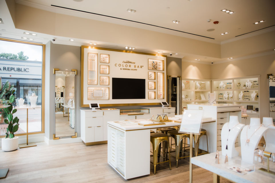 A showroom with various Kendra Scott products on different display mannequins