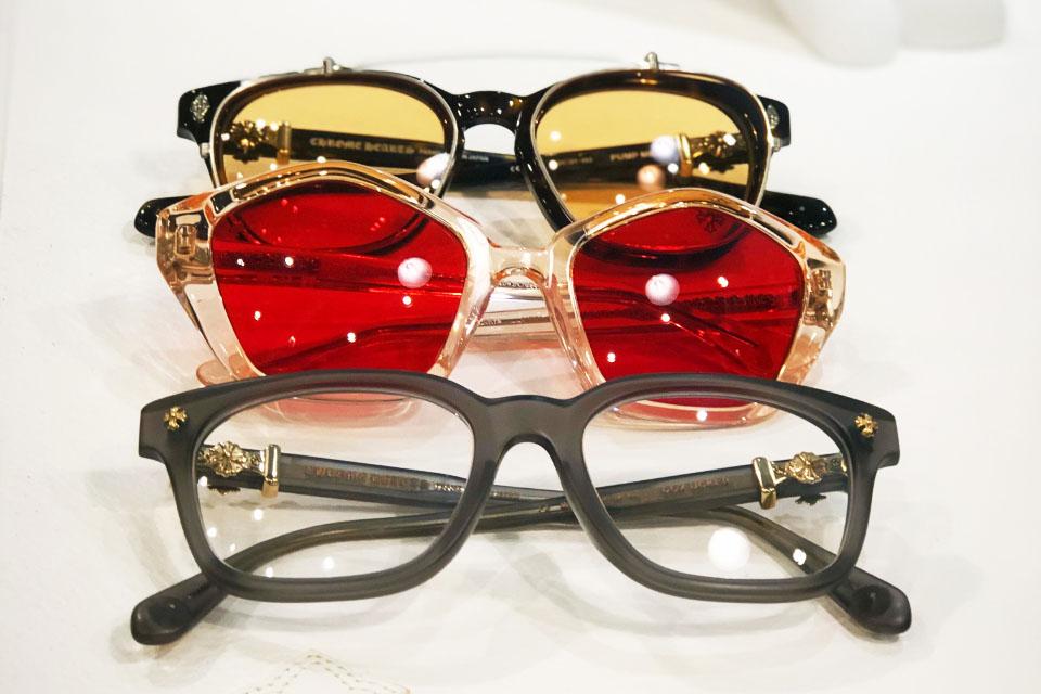 A close up of three pairs of stylish eyeglasses
