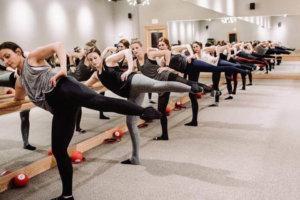 Several women exercising in unison