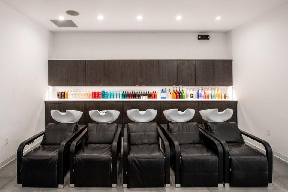 A row of 5 shampoo chairs