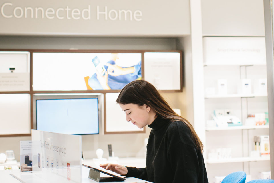 A woman on her tablet inside of the xfinity showroom