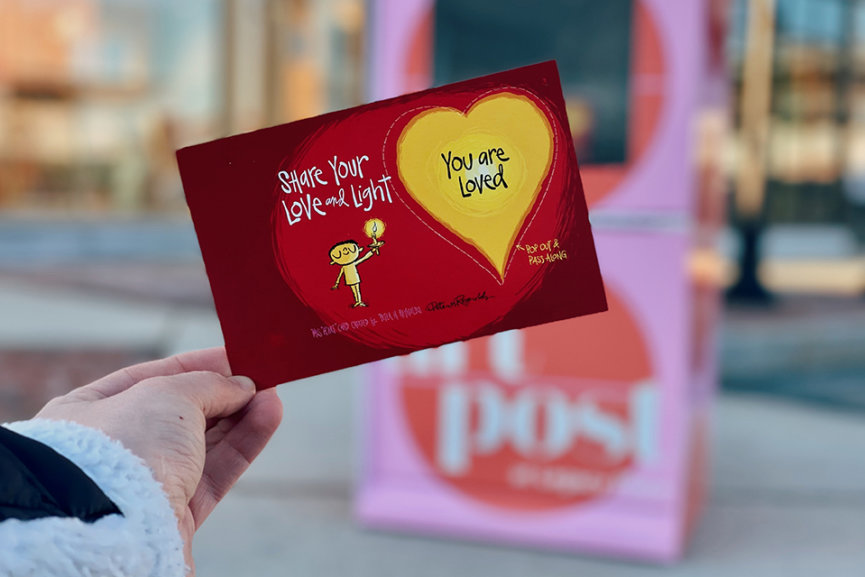 A card that says share your love and light